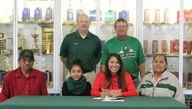 Farmington's Tanisha Beetso signed her national letter of intent on Thursday at Farmington High School to play basketball at Central Lakes College in Brainerd, Minn.