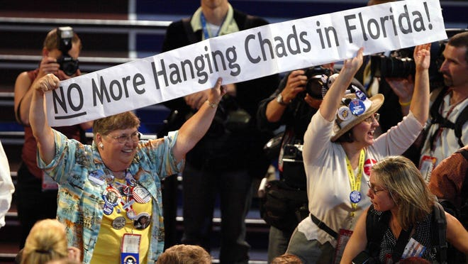 """Delegates carry a banner reading """"No more hanging chads in Florida"""" across the floor on opening night of the 2004 Democratic National Convention Monday night in Boston."""