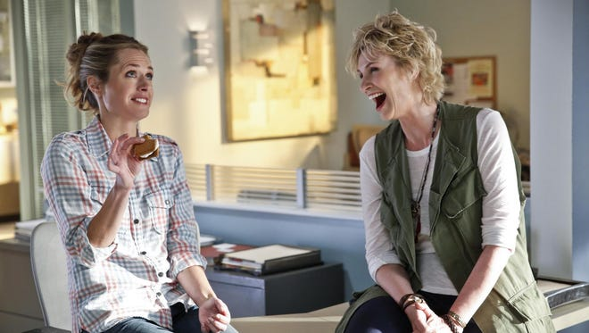"""In this image released by CBS, Maggie Lawson, left, and Jane Lynch appear in a scene from """"Angel From Hell,"""" premiering Nov. 5, on CBS."""