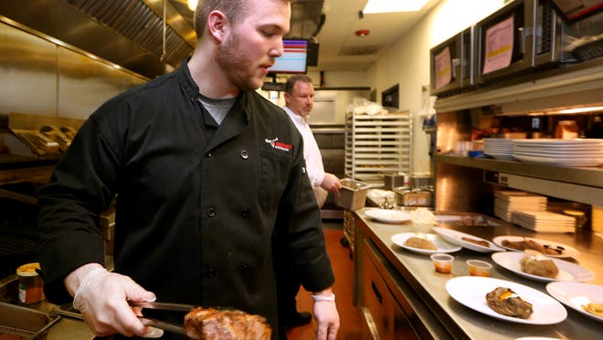 Christian Singleton, who earned grill master status, flips an Outlaw Ribeye at the Murfreesboro LongHorn Steakhouse.
