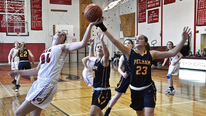 Rye's Ellie Dailey and Pelham's Sam Volpe battle for rebound during first-round Class A playoff game.