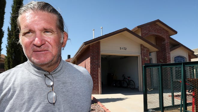U.S. Navy veteran John Rhodes talks to the media outside his home in Northeast El Paso Thursday. After going through a period of homelessness, Rhodes, 56, is moving into the home after receiving a Department of Housing And Urban Development-Veterans Affairs Supportive Housing voucher.