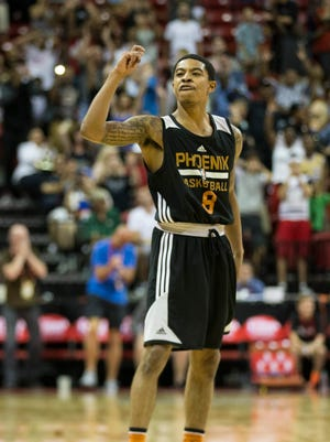 Phoenix Suns' Tyler Ulis (8) reacts after making a shot at the buzzer shot to defeat the Denver Nuggets 82-81 in overtime an NBA summer league basketball game at the Thomas & Mack Center on Saturday, July 16, 2016, in Las Vegas.