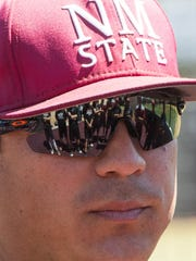 Anthony Claggett, NMSU pitching coach talks with pitchers