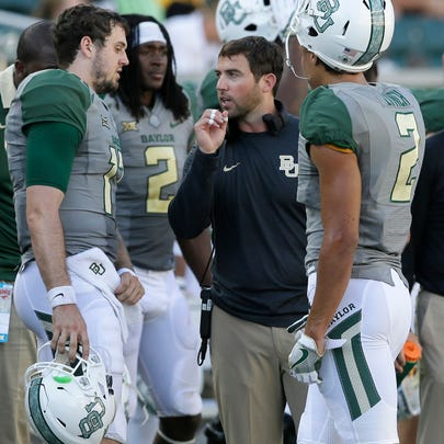Baylor offensive coordinator Kendal Briles, center, talks to quarterback Seth Russell (17) and wide receiver Blake Lynch (2) during the second half of an NCAA college football game against SMU, Saturday, Sept. 10, 2016, in Waco, Texas. (AP Photo/LM Otero)