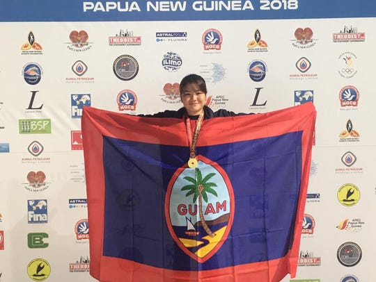 Mineri Gomez with her gold medal after the 5K Ocean swim at the Oceania Championships in Papua New Guinea on June 26.