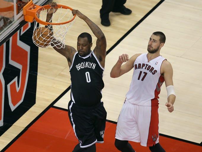 Game 7 in Toronto: Nets 104, Raptors 103 — Nets big man Andray Blatch dunks in front of Raptors center Jonas Valanciunas.