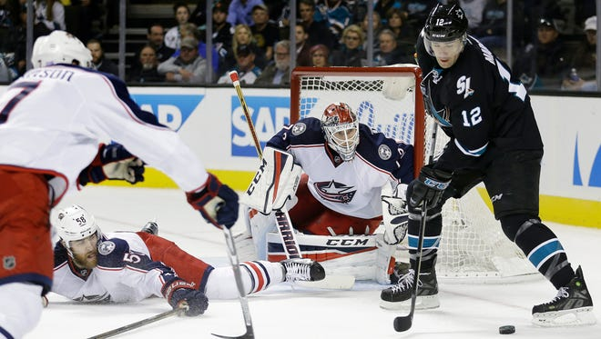 Columbus Blue Jackets goalie Sergei Bobrovsky, center, defends against San Jose Sharks' Patrick Marleau (12) during the first period of an NHL hockey game Thursday, Oct. 27, 2016, in San Jose, Calif. Blue Jackets' David Savard (58).