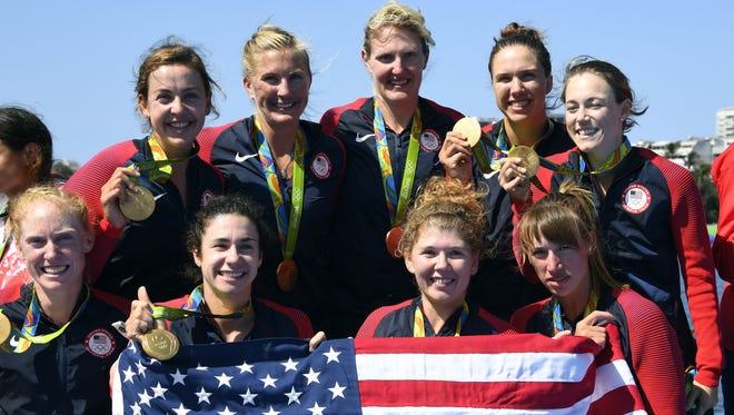 Gold medallists Katelin Snyder, Kerry Simmonds, Emily Regan, Amanda Polk, Eleanor Logan, Lauren Schmetterling, Amanda Elmore, Meghan Musnicki (top row, second from left) and Tessa Gobbo celebrate on the podium.