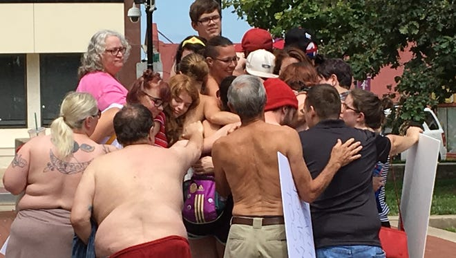 Protesters at the Free the Nipple rally at Park Central Square on Saturday have a group hug after an emotional speech.