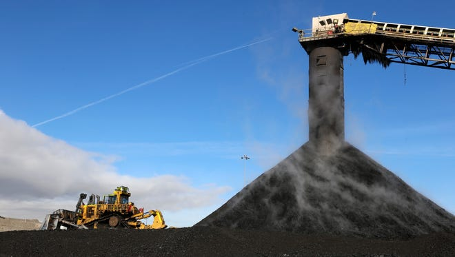Coal moves on a conveyor belt and is deposited at a collection site on Jan. 13 at the San Juan Mine in Waterflow.