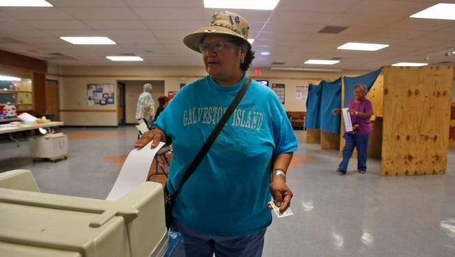 Dianna Yazzie-Nez casts her ballot on Tuesday at the Coyote Canyon Chapter House.