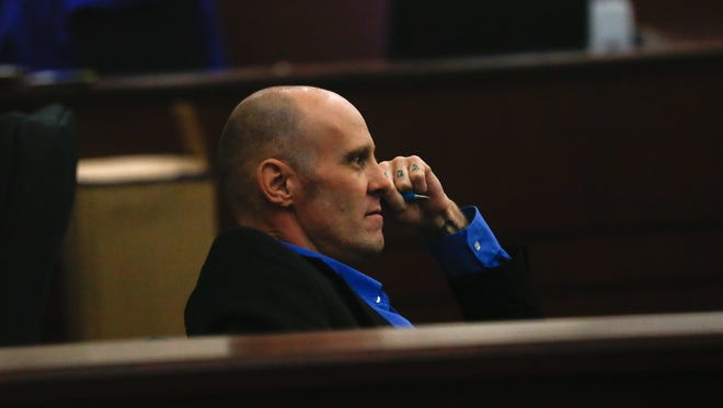 Defendant Kenneth Burrows listens Friday during his murder trial at District Court in Aztec.