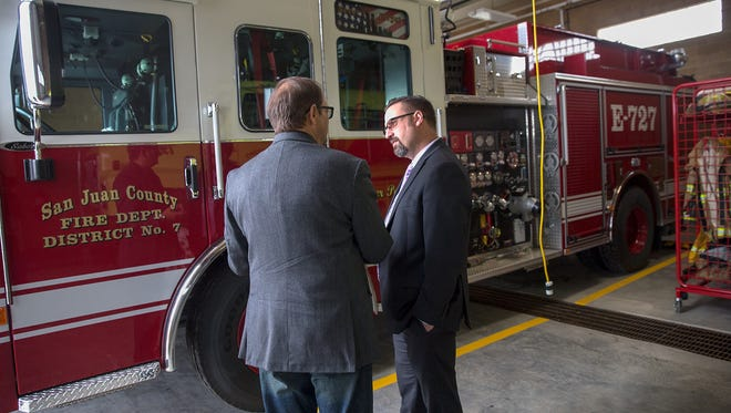 San Juan County Commissioner John Beckstead, left, is seen on May 16, 2017, during a tour of the San Juan County Fire Center Point Station 2. Beckstead has been chosen to serve as the County Commission chairperson.