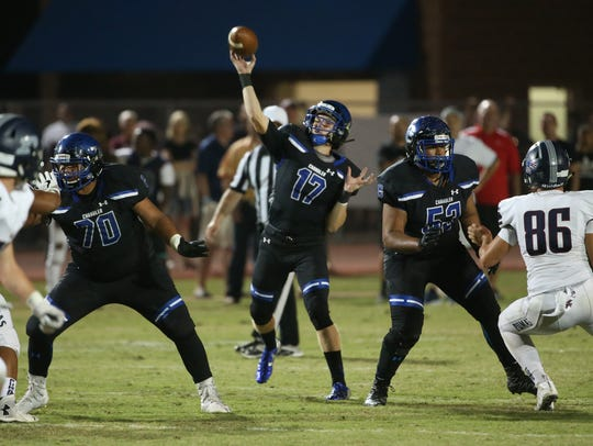 Chandler's Jacob Conover (16) throws a touchdown pass