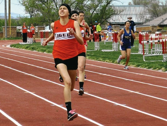Adrianna Romero powers her way to the finish in the 400 meter dash at the Grizzly Relays in Carrizozo, April 2.
