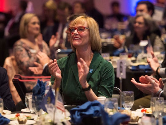 Lt. Gov. Suzanne Crouch, middle, applauds Southwest Indiana Chamber President Tara Barney (not pictured) during a luncheon at the Old National Events Plaza on Friday, March 16, 2018.