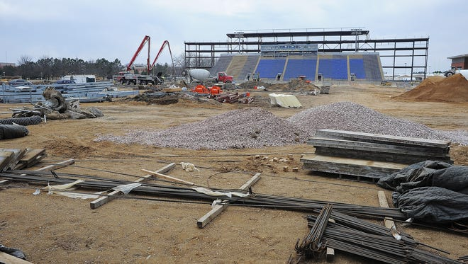 Construction crews work at the construction site of the new South Dakota State University football stadium on Wednesday.