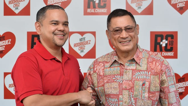 Gubernatrial candidate Sen. Dennis Rodriguez Jr. shakes the hand of his running mate, Dave Cruz, at a campaign event in Yigo on March 10, 2018.