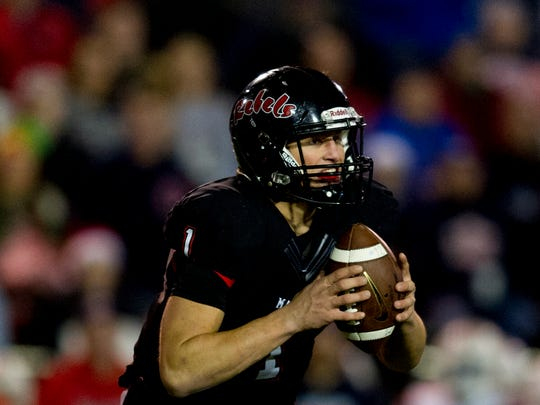 Maryville's Dylan Hopkins (1) looks to pass during the semifinal round TSSAA football playoffs between Maryville and Oakland high schools at Maryville High School in Maryville , Tennessee on Friday, November 24, 2017.