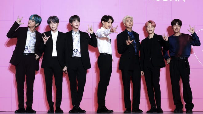 "The South Korean pop group BTS poses for photos during a Seoul news conference in April 2019 to introduce the album ""Map of the Soul: Persona."""