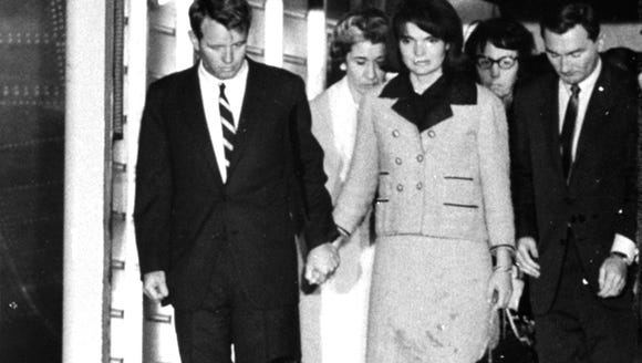 Jackie Kennedy and Robert F. Kennedy watch the casket