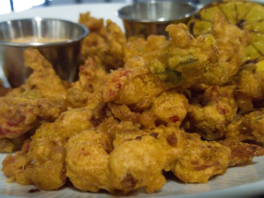 Do order the Cajun crawfish fritters at Bubba.