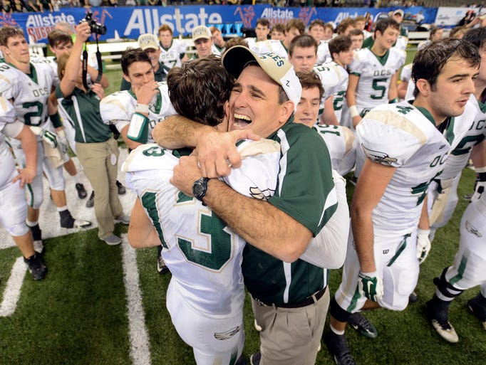 Ouachita Christian head coach Steven Fitzhugh hugs
