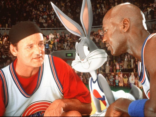 "Bill Murray, Bugs Bunny, and Michael Jordan draw up a play in ""Space Jam."""