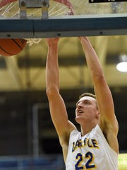 Castle's Jack Nunge slams a dunk home in the second quarter of Thursday night's matchup with the Bosse Bulldogs in Newburgh, February 4, 2016.