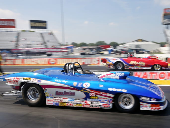 Cars take off the line while competing in the Super Gas class during the opening day of the 60th annual Chevrolet Performance U.S. Nationals held at Lucas Oil Raceway in Indianapolis on Thursday, August 28, 2014.