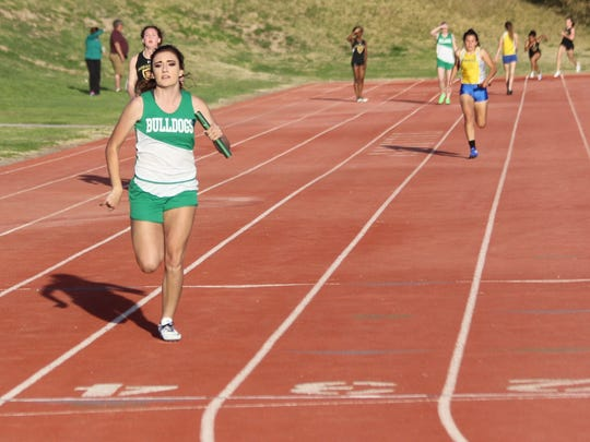 Kaydee Bingham glides to the finish line to complete Virgin Valley's win in the girls' 4x100 relay Wednesday.