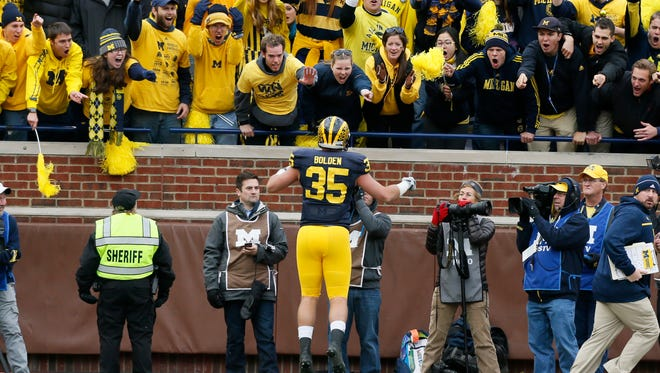 Michigan's Joe Bolden jumps up and down yelling at the student section as he leaves the field after being ejected from the game in the second quarter againsT Michigan State on Oct. 17.