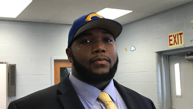 Washington was introduced as Carroll's new football coach and athletic director on Thursday.