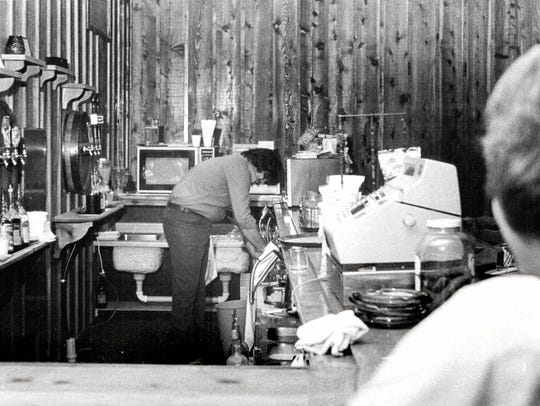 May 19, 1978: Bartender John Abbo cleans liquorless