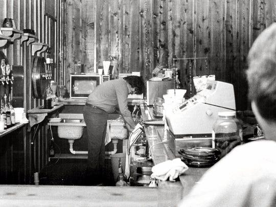 May 19, 1978: Bartender John Abbo cleans liquorless