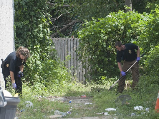 Camden County Police officers look for evidence near