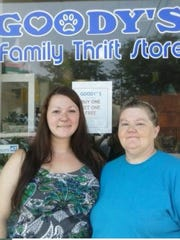 "BobbieSue Cole, left, and her mother Beth Marschie, stand in front of their recently opened store ""Goody's Family Thrift Store"" located at 14 E. Fifth St., in Fond du Lac."