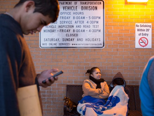 Seventeen-year-old Juan Payan (left) waits for the