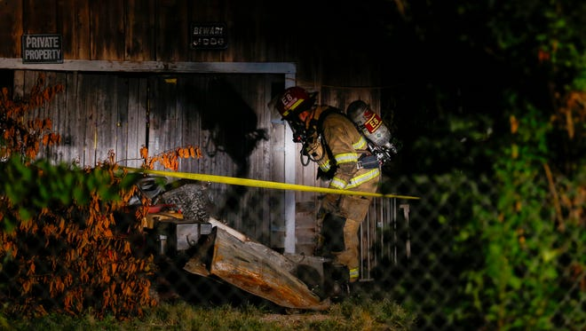 Fire crews work the scene of a fatal fire on Aug. 23, 2016.