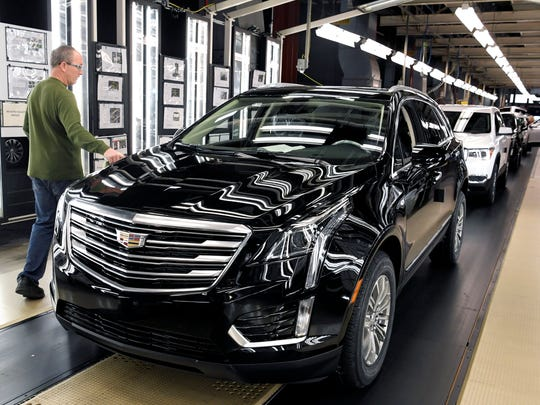 General Motors'  Spring Hill Manufacturing employee Tim Fitzpatrick works the quality Inspection line as Cadillac XT5 and the GMC Acadia vehicles are been made in Spring Hill on Wednesday, Feb. 14, 2018.