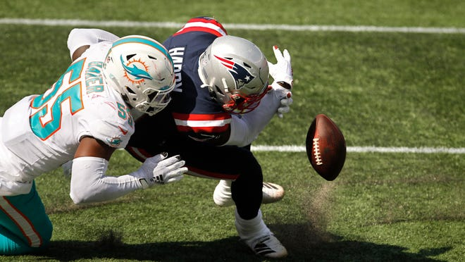 Patriots receiver N'Keal Harry fumbles the ball near the goal line as he is tackled by the Dolphins' Jerome Baker in the third quarter. Since the ball went through the end zone, it was ruled a touchback and Miami got possession.