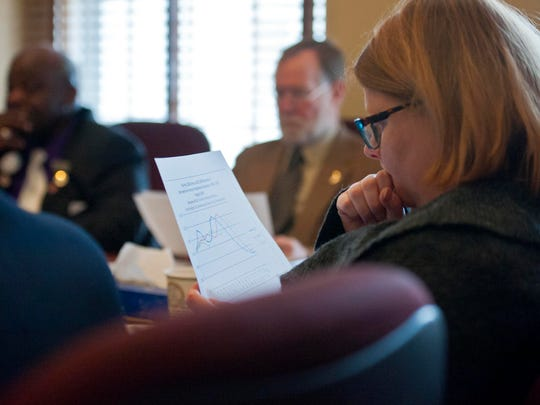 Rep. Sarah Buxton, D-Tunbridge, studies a graph showing the projected decline in the state's population as Bill Talbott, deputy commissioner at the Agency of Education briefs the House Education Committee at the Statehouse in Montpelier on Friday.