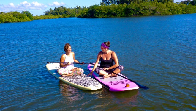 Stephanie Testa and Michelle Mulak handle holiday stress, Florida style. This is the perfect time of year to head out and explore the lagoon on a SUP.