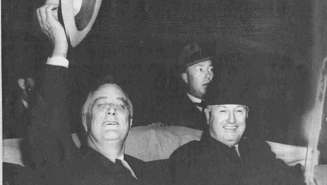 James A. Farley, right, sits beside a hat-waving President Franklin D. Roosevelt after watching the Washington Senators play in Washington D.C. in April 1940. Rare film footage was released featuring President Roosevelt walking to his seat at the 1937 All-Star game in Washington.