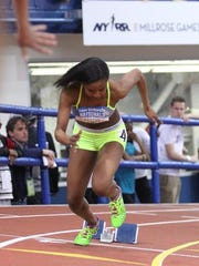 New Rochelle's Symone Darius is off the blocks in the