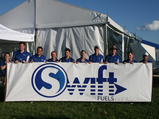 Representatives from Swift Fuels LLC at an industry event in Wisconsin to promote their product.