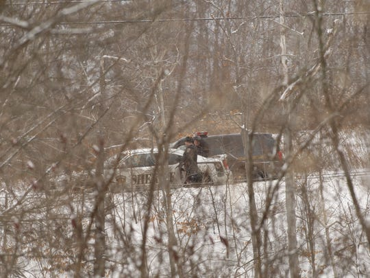 Police stand by on Route 366 in Etna Tuesday afternoon for an apparent standoff incident at a building on the road.