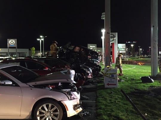 Man Crashes Vehicle On Top Of 5 Cars At Troy Dealership