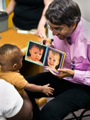 Dr. Dipesh Navsaria is seen in 2011 at the University of Wisconsin School of Medicine and Public Health's free student-run clinic at the Salvation Army Family and Women's Shelter in Madison, Wis., Here, Navsaria, an associate professor of pediatrics, puts the Reach Out and Read early literacy program in action. Navsaria is the medical director for Reach Out and Read in Wisconsin.
